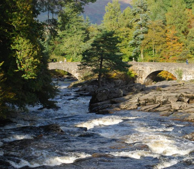 The falls of dochart in highland Perthshire and an old stone bridge